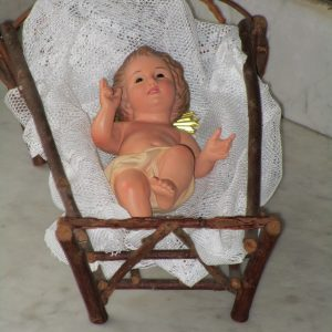 Baby jesus with wooden cradle