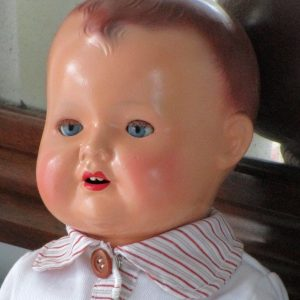German ceramic doll with glass eyes