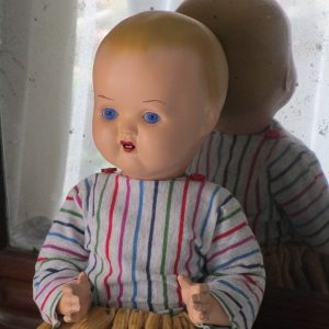 Celluloid doll with glass eyes