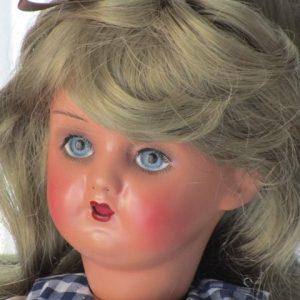 Muñeca composición ojos azules