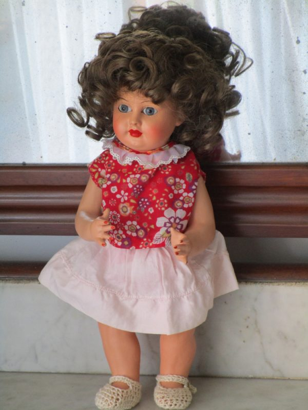 Doll with papier-mâché body and celluloid head marked with the letters rs 1