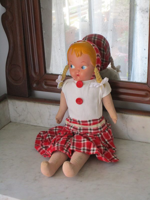 1950s celluloid-faced clothing doll
