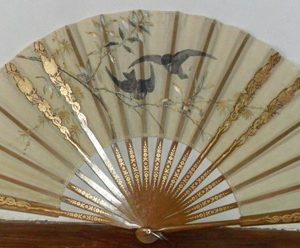 Pericon hand fan with wooden sticks and golden decoration