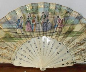 Isabelline hand fan with decorated bone sticks