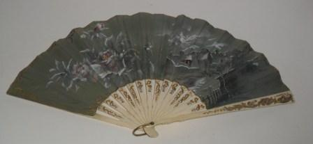 Hand fan made of black tulle and bone sticks