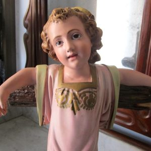 Antique Baby jesus on the cross with glass eyes